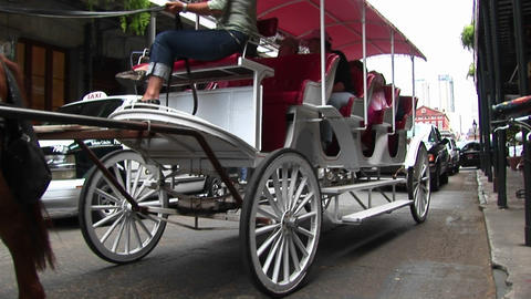A horse-drawn tourist carriage makes its way down a... Stock Video Footage