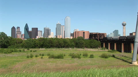 Dallas Texas on a sunny day with a freight train passing Stock Video Footage