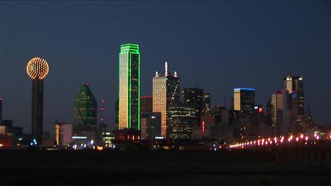 Lights illuminate the downtown Dallas, TX skyline Stock Video Footage
