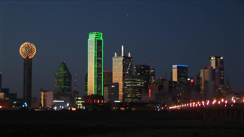 Lights illuminate the downtown Dallas, TX skyline Stock Video Footage