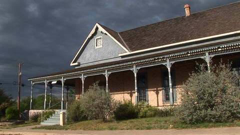 Medium-shot of a ranch house as storm clouds gather... Stock Video Footage
