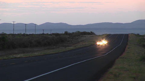Medium shot of four motorcycles on a rural Texas roadway Stock Video Footage