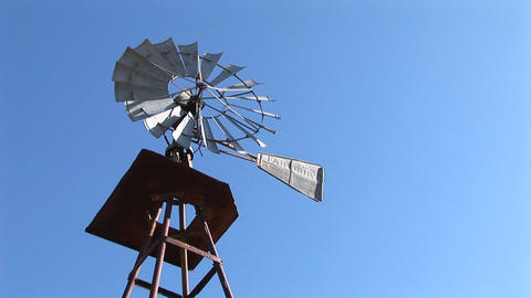 Worm's-eye-view of a windmill spinning in the breeze Stock Video Footage