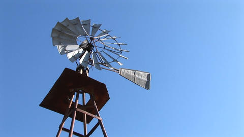 Worm's-eye-view of a windmill spinning in the breeze Footage