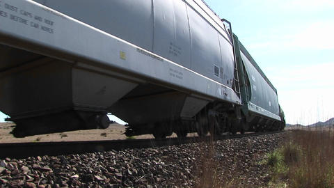 Close-up of a train moving across tracks on the desert Stock Video Footage