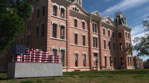Tilt up to an old Victorian building with an American... Stock Video Footage