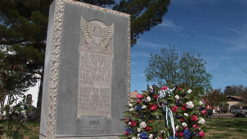 Medium-shot of a veteran's headstone and wreath Footage