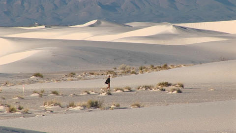 Long-shot of a hiker walking through White Sands National Monument in New Mexico Footage