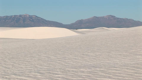 Long-shot of distant mountains and sand dues at White Sands National Monument in New Mexico Footage