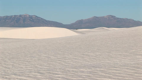 Long-shot of distant mountains and sand dues at White... Stock Video Footage