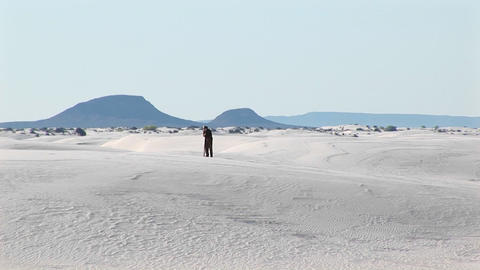 Long-shot of a photographer setting up a tripod in White... Stock Video Footage