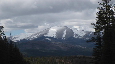 Long-shot of a snowy peak in the Sierra Blanca Mountain Range in New Mexico Footage