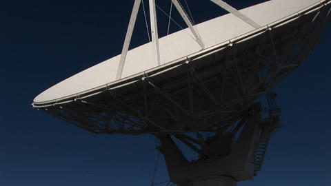 Pan-up of a satellite dish at the National Radio Astronomy Observatory in New Mexico Footage