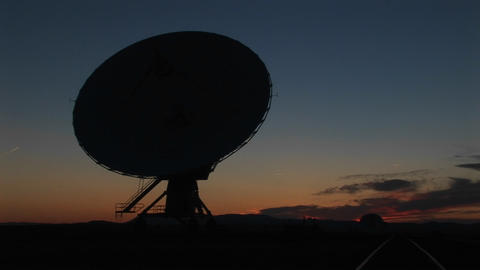 Medium-shot of a silhouette of a satellite dish in the... Stock Video Footage