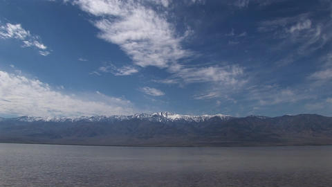 Long-shot of the Badwater Lake with the Owlshead Mountains on the horizon in Death Valley National P Footage