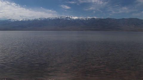 Long-shot of the Badwater Lake and Owlshead Mountains in... Stock Video Footage