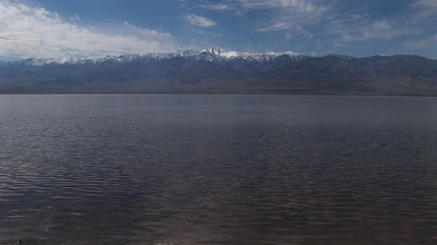 Long-shot of the Badwater Lake and Owlshead Mountains in Death Valley National Park Footage