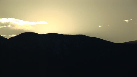 Long-shot of silhouetted hills at golden hour in Death... Stock Video Footage
