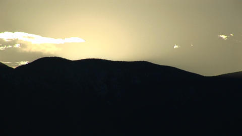 Long-shot of silhouetted hills at golden hour in Death Valley National Park Footage