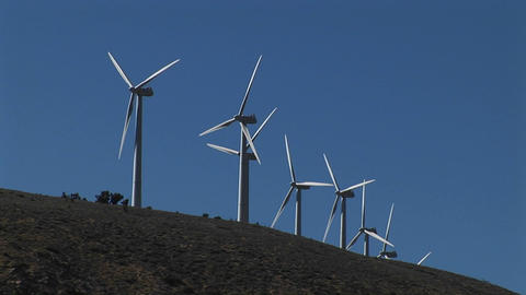 Medium shot of wind turbines generating power in... Stock Video Footage