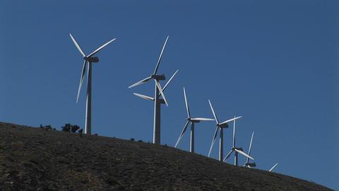Medium shot of wind turbines generating power in... Stock Video Footage
