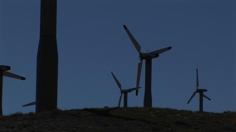 Medium-shot of several wind turbines generating power at... Stock Video Footage