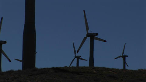 Medium-shot of several wind turbines generating power at... Stock Video Footage