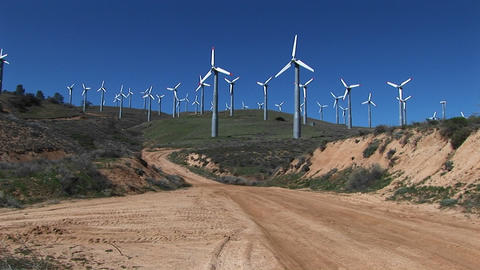 Long-shot of numerous wind turbines generating power at Tehachapi, California Footage