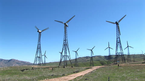 Long-shot of several wind turbines generating power at Tehachapi, California Footage