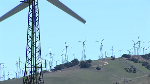 Close-up of one wind turbine with numerous turbines in... Stock Video Footage
