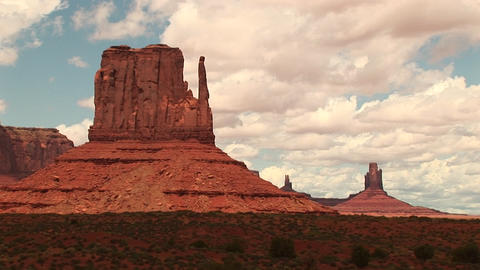 Long-shot of the Mittens formation at the Monument Valley Tribal Park in Arizona and Utah Footage