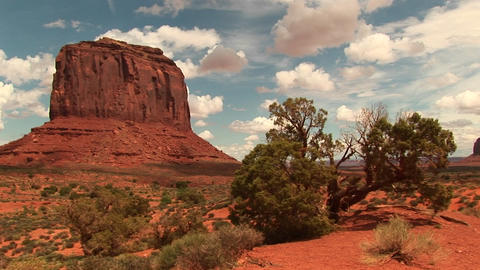Long-shot of a sandstone formation at Monument Valley Tribal Park in Arizona and Utah Footage
