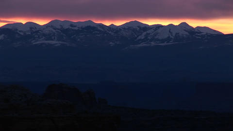 Long-shot of the La Sal Mountains silhouetted at golden-hour Stock Video Footage