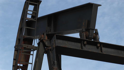 Close up of an oil pump turning in the New Mexico desert Stock Video Footage