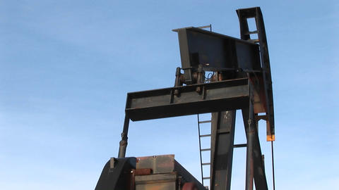 Close-up of an oil pump turning in the New Mexico desert Stock Video Footage