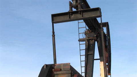Close-up of an oil pump turning in the New Mexico desert Footage