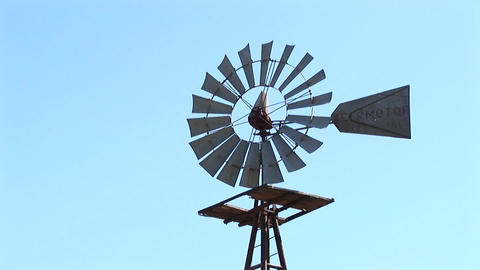 Close-up of a windmill turning in the breeze Stock Video Footage