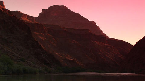 Pan-right shot of the Colorado River flowing through the Grand Canyon Footage