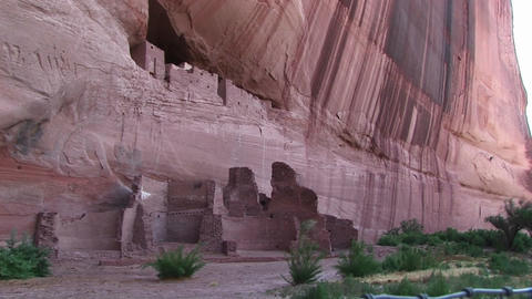 Pan-down shot of cliff dwellings in Canyon De Chelly... Stock Video Footage
