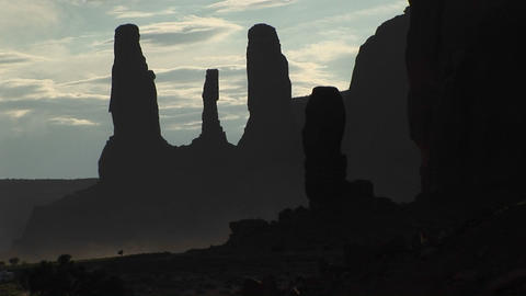 Medium shot of the silhouetted Three Sisters rock... Stock Video Footage