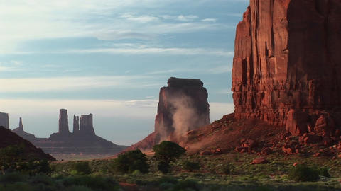 Medium shot of sandstorm dust blowing through Monument Valley Tribal Park in Arizona Footage