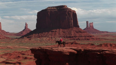 Long shot of a cowboy riding his horse to Vista Overlook... Stock Video Footage