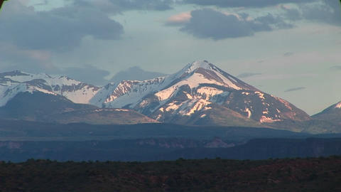 Long shot of the La Sal Mountains at golden-hour Stock Video Footage