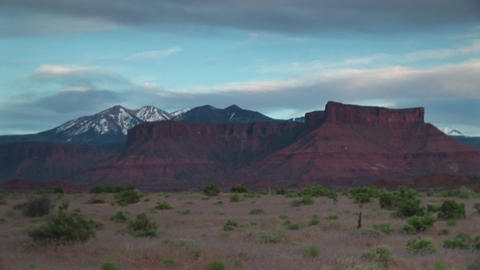 Medium shot of Castle Rock standing in front of the La Sals Mountains in Utah Footage