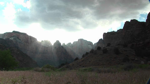 Long shot of rays of sunlight filtering over mountain... Stock Video Footage