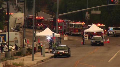 Medium shot of waiting fire trucks and news crews near a... Stock Video Footage