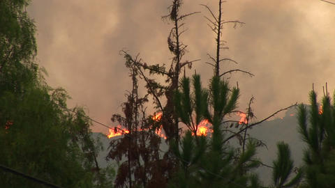 Long shot of wildfires burning on the top of a ridge in... Stock Video Footage