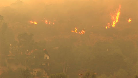 Pan-up shot of fires raging near a Southern California... Stock Video Footage