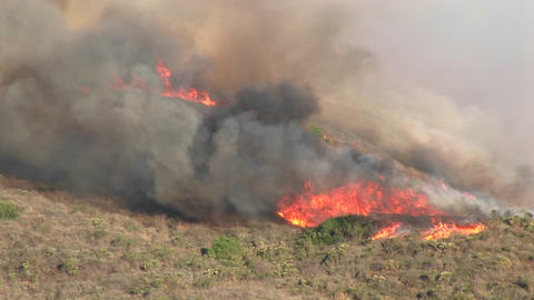 Long shot of wildfires burning on a hillside in southern... Stock Video Footage