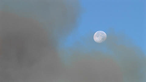 Long shot of clouds of dark smoke clearing to reveal the... Stock Video Footage
